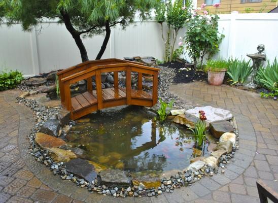 Water garden koi pond installation project in staten for Garden pond installers